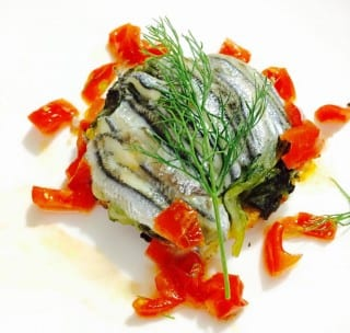 Tortino di scarola di pesce azzurro profumato al finocchio e pomodorino fresco